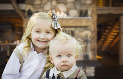 Cute Brother and Sister Pose In Rustic Cabin Royalty Free Stock Image
