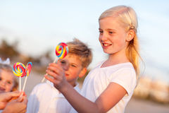 Cute Brother and Sisters Picking out Lollipop Stock Photo