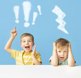 Cute brothers with cloud marks Stock Photo