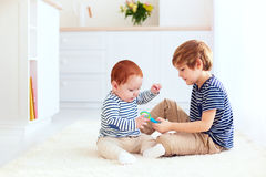Cute brothers playing together at home Royalty Free Stock Image