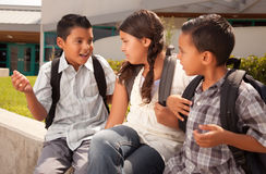 Cute Brothers and Sister Ready for School. Cute Brothers and Sister Wearing Backpacks Ready for School Stock Photo