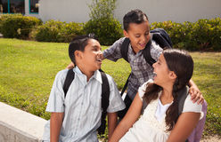Cute Brothers and Sister Talking, Ready for School. Cute Brothers and Sister Talking, Wearing Backpacks Ready for School Stock Images