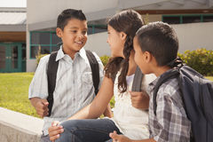 Cute Brothers and Sister Talking, Ready for School. Cute Brothers and Sister Talking, Wearing Backpacks Ready for School Royalty Free Stock Image
