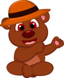 Cute brown bear cartoon sitting with hat Stock Photography