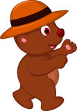 Cute brown bear cartoon walking with hat Stock Photo