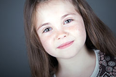 Cute Brown Haired Child Smiling Royalty Free Stock Photography