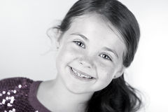 Cute Brown Haired Child Smiling at the Camera Royalty Free Stock Photos