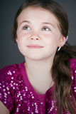 Cute Brown Haired Girl Looking Up Off Camera Royalty Free Stock Images