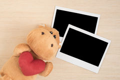 Cute brown hippo doll with instant photo frames Royalty Free Stock Photo