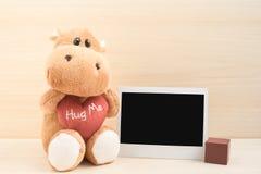Cute brown hippo with polaroid frame Stock Photos