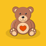 Cute brown teddy bear with red heart on yellow background. Royalty Free Stock Image