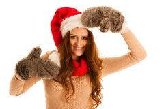 Cute brunete girl in santa claus dress with presents for christm Royalty Free Stock Image