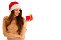 Cute brunete girl in santa claus dress with presents for christm Stock Images
