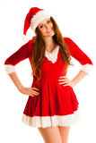 Cute brunete girl in santa claus dress with presents for christm Stock Photography