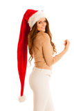 Cute brunete girl in santa claus dress with presents for christm Stock Photos