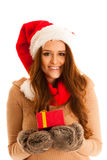 Cute brunete girl in santa claus dress with presents for christm Stock Photo