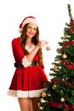 Cute brunete girl in santa claus dress with presents for christm Royalty Free Stock Photography