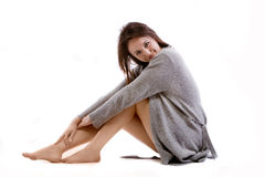 Cute brunette. Sitting in jumper isolated on white background Stock Photo