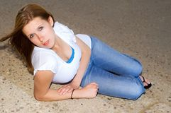 Cute brunette. Laying on concrete stairs Stock Photos