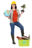 Cute brunette apprentice holding globe Royalty Free Stock Photos