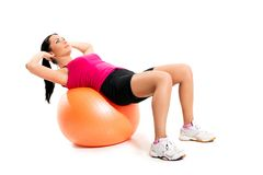 Cute brunette on the ball Royalty Free Stock Photos