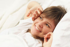 Cute brunette in bed Stock Image