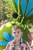 Cute brunette boy eleven years old. In flowers background royalty free stock photos