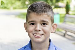 Cute brunette boy eleven years old. In summer background royalty free stock image