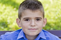 Cute brunette boy eleven years old. In summer background stock photography