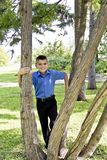 Cute brunette boy eleven years old. In summer park royalty free stock photos