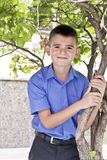 Cute brunette boy eleven years old. In summer background stock photos