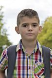 Cute brunette boy eleven years old. In summer background royalty free stock photography