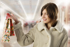 Cute brunette with christmas purchase Royalty Free Stock Photography