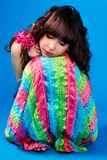 Cute brunette in a colorful dress is sleeping Royalty Free Stock Photography