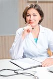 Cute brunette Doctor working in the office Stock Photo
