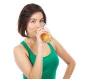 Cute brunette drinking an orange juice Royalty Free Stock Photo