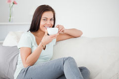 Cute brunette drinking tea Royalty Free Stock Image