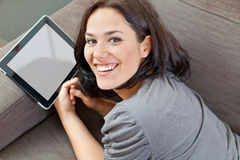 Cute brunette and electronic tablet Stock Photo