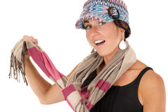 Cute brunette female holding striped scarf wearing Stock Images