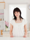 Cute brunette female posing while standing Royalty Free Stock Images