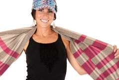 Cute brunette female stretching scarf out on shoul Stock Photo