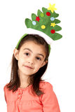 Cute brunette girl in christmas tree hat Royalty Free Stock Image