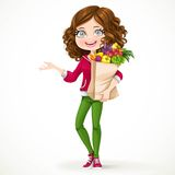 Cute brunette girl with curly hair holding a paper bag Stock Images