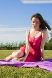 Cute brunette girl enjoys sun in park Royalty Free Stock Images