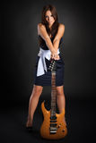 Cute brunette girl with guitar Royalty Free Stock Images