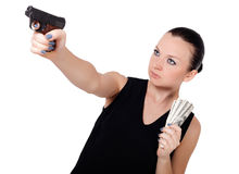 Cute brunette girl with gun Royalty Free Stock Photography