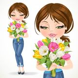 Cute brunette girl holding beautiful bouquet of tulips Stock Photo