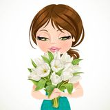 Cute brunette girl holding beautiful bouquet white tulips on whi Stock Photography