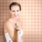 Cute brunette girl pointing with laundry peg Stock Photography