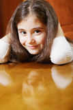 Cute brunette girl sitting at table Royalty Free Stock Images